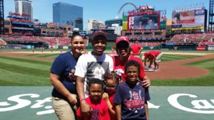 As Father of the Year, Carl Williams threw out the first pitch for the St. Louis Cardinals with his family looking on.